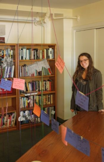 Abby stands with her floating, interdisciplinary Brooklyn Bridge Project.
