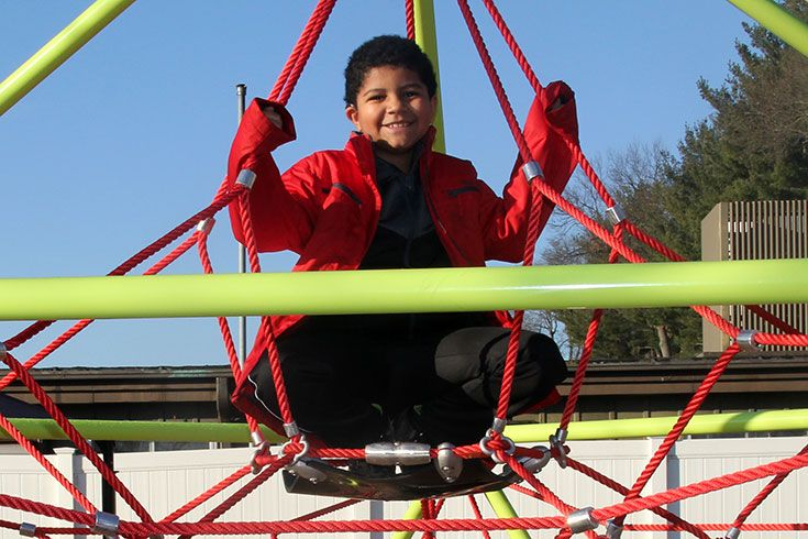 Boy sitting on a playground structure