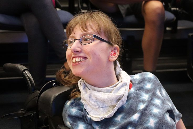 Smiling girl in a wheelchair