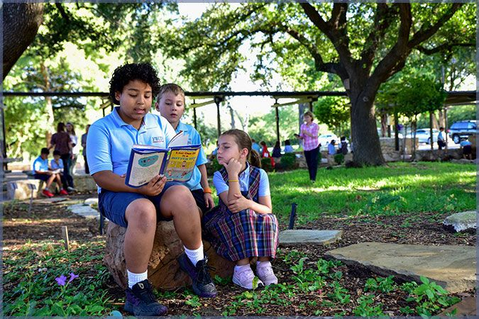 Sharing books in the Discovery Garden.