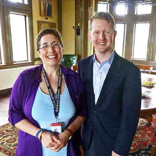 Caption: Dr. Pierce interviews guest speaker Ken Jennings.