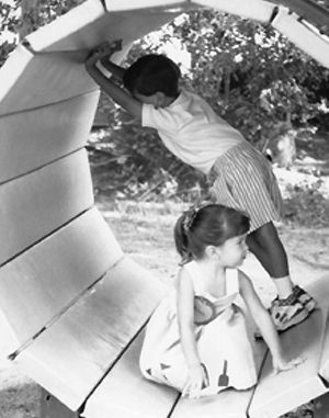 Mid 1960s - Kindergarten students enjoy playground equipment.