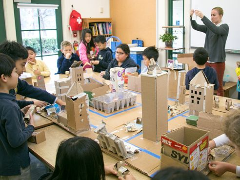 Collaborative class projects, like this cardboard city, are part of the art curriculum.