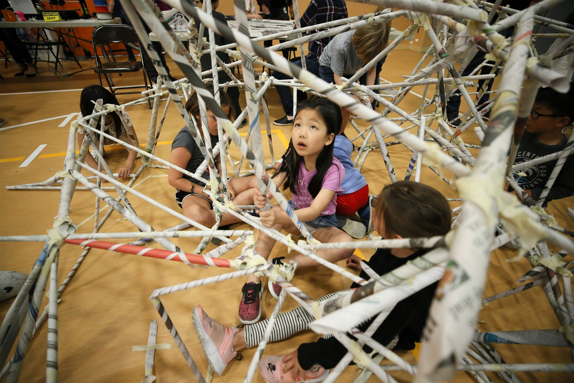 Families enjoy exploring 30+ interactive activity stations focused on science, technology, engineering, arts, and math at the yearly STEAM Festival.