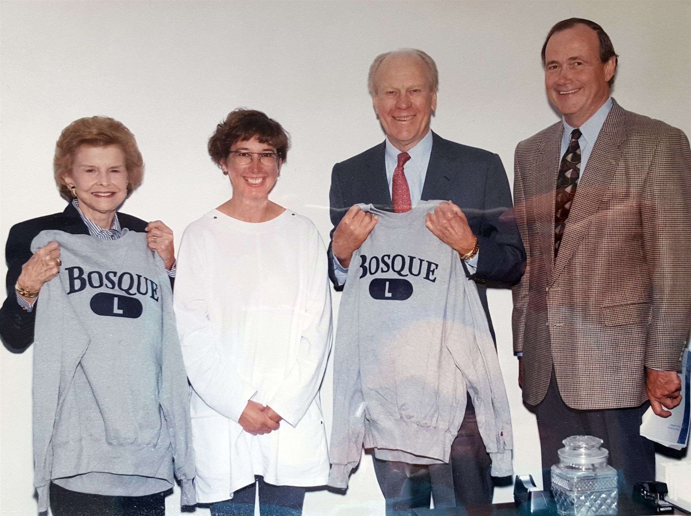 Bosque's founder Peggie Ann Findlay and 1st Head of School Dr. Gary Gruber giving President Gerald Ford and Betty Ford the first Bosque sweatshirts