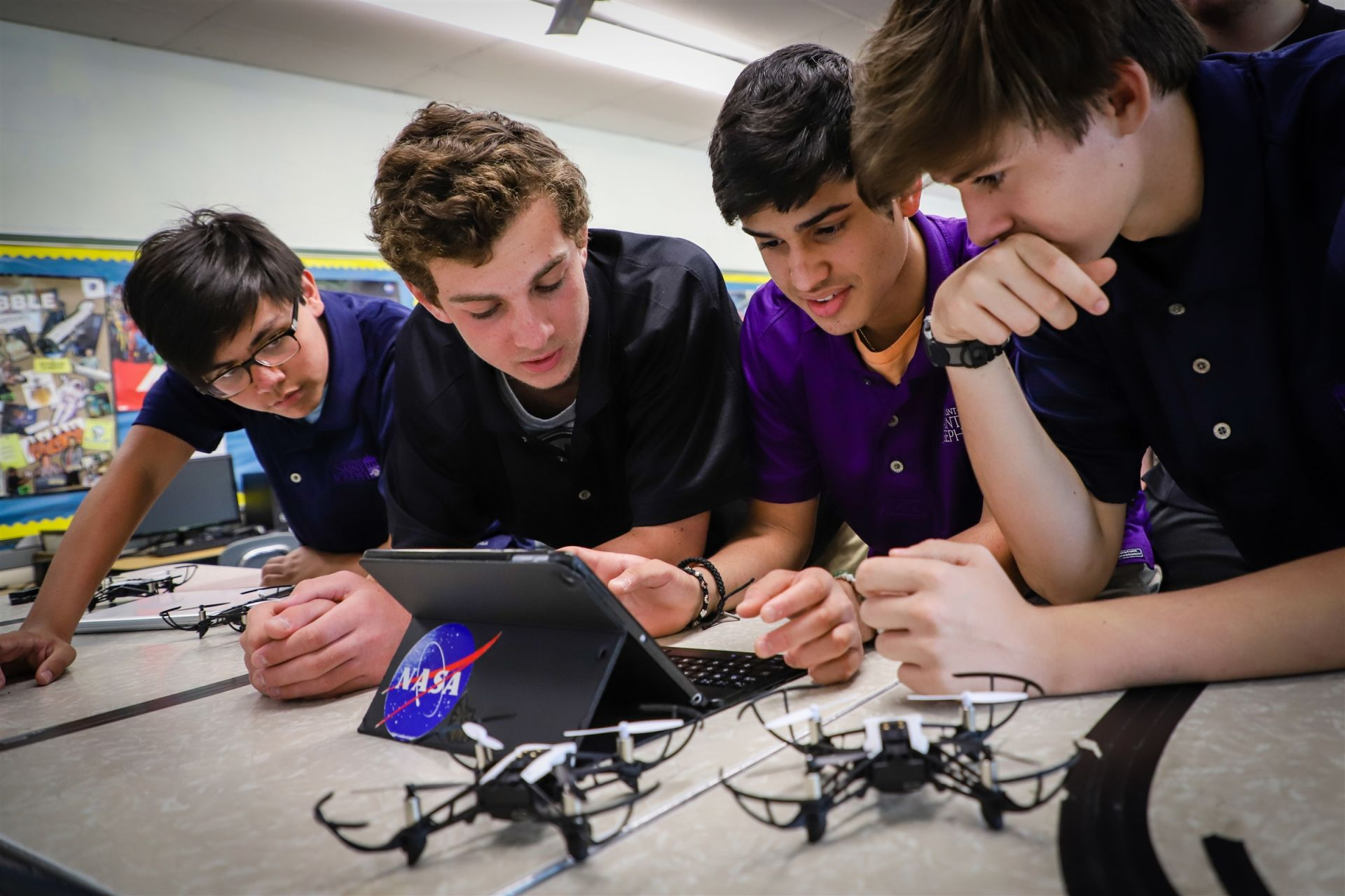 Students program drones at summer STEM camp.