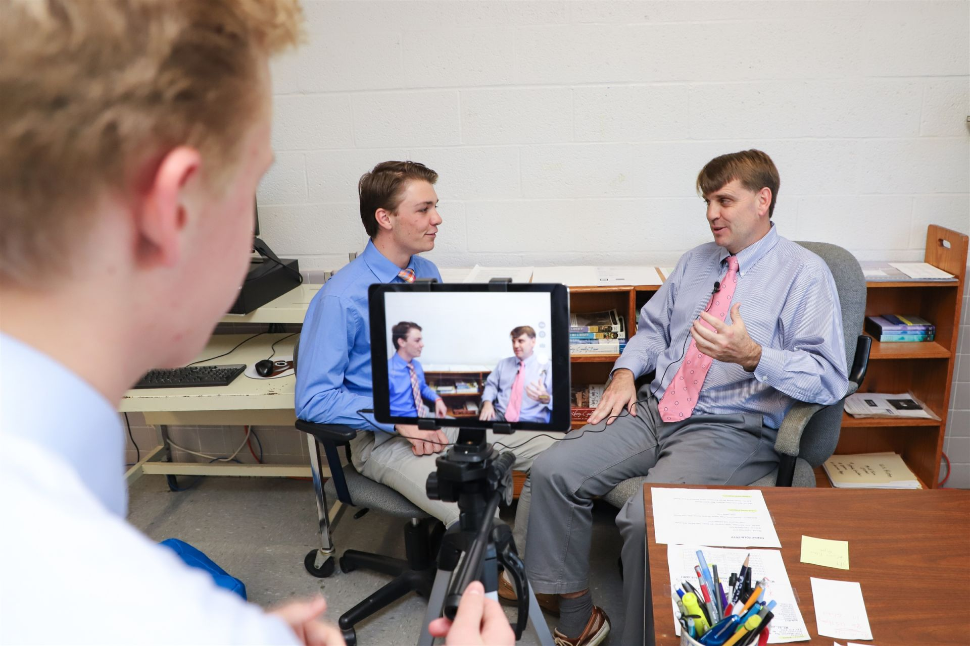 Student conducts interview for live broadcast in Multimedia Journalism class.