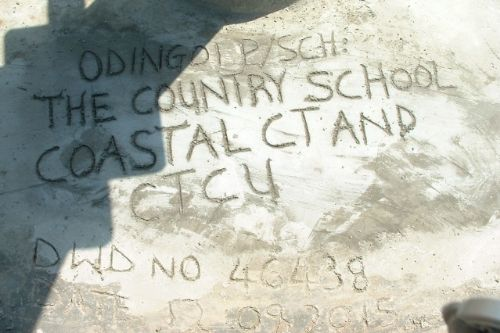 A plaque from a well in rural Uganda that Country School students helped build through a year-long fundraising effort.