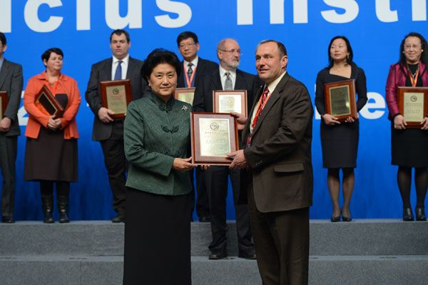 Vice Premier of China, Liu Yandong, presents Head of School Frank Phillips with the Confuicus Classroom of the Year plaque at the opening ceremony of the 8th International Confucius Institute Conference on December 7, 2013 in the Chinese National Convention Center in Beijing.