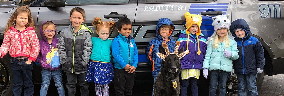 Group of kids with police K9