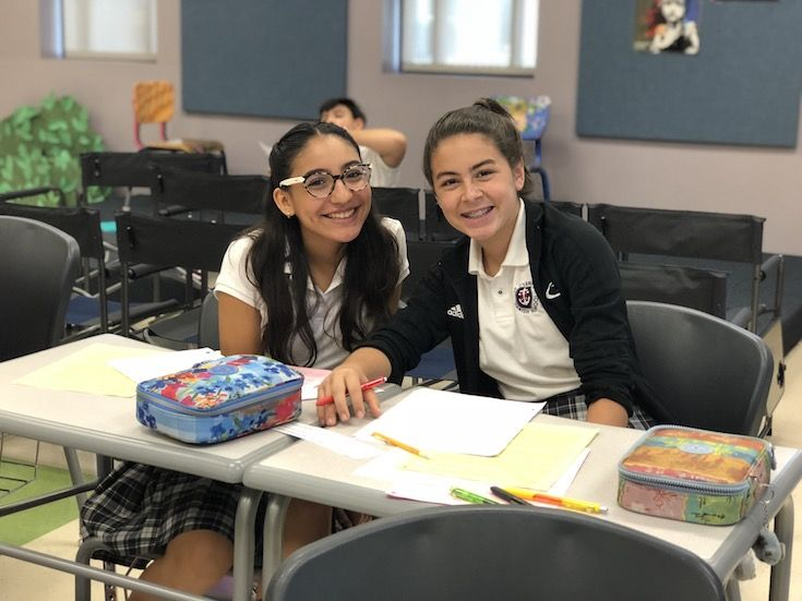 Two students in class at St. Clement
