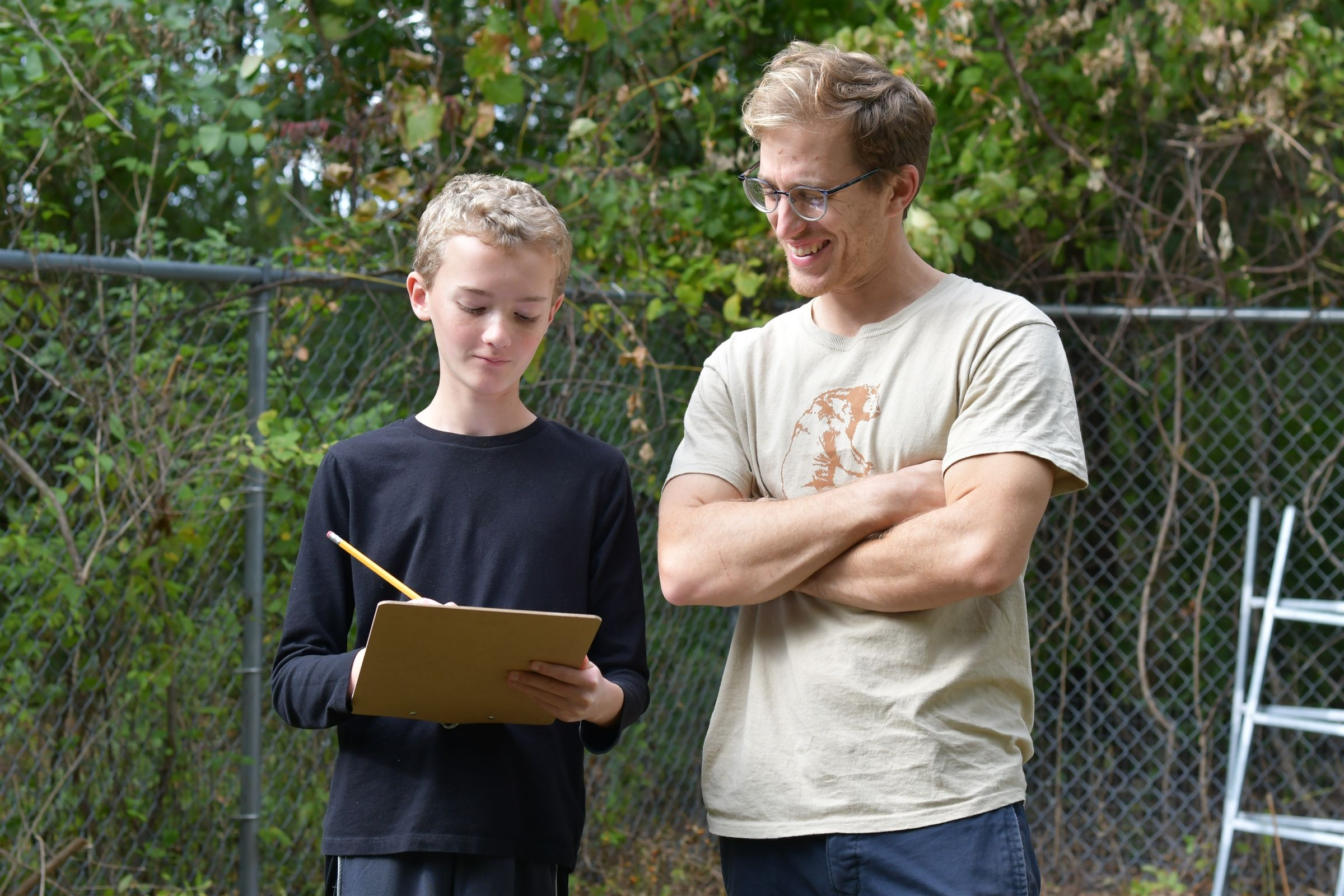 A Student Working with Outdoor Education Coordinator Cody Murnen
