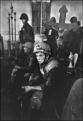 "Photographer Frank Johnston's famous photo of Mike Tripp entitled: ""An exhausted Marine finds refuge inside a church in An Hoa during a heavy North Vietnamese Mortar Attack"""