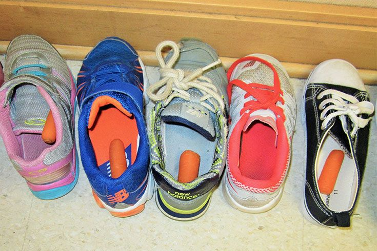 "Students participate in delightful Christmas traditions from around the world, such as the Swedish practice of leaving shoes outside for ""Sinter Klaus,"" hoping he will fill them with candy and feed the carrots to his reindeer."