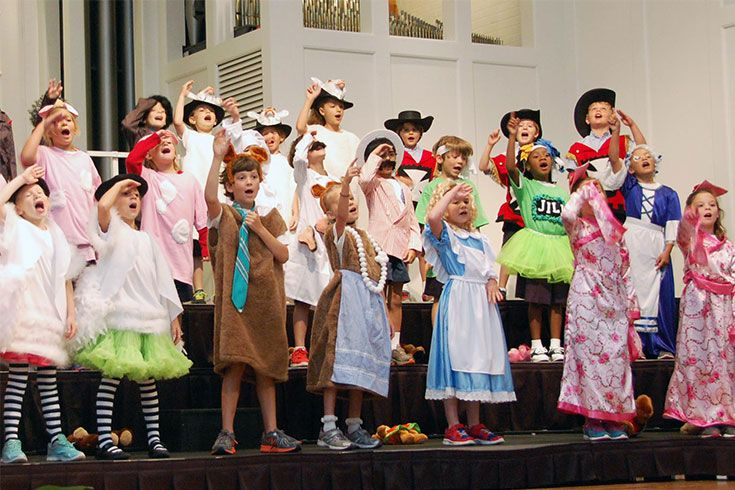 Students build confidence on stage in the first grade musical—one of many public performances during their years at ROBS.