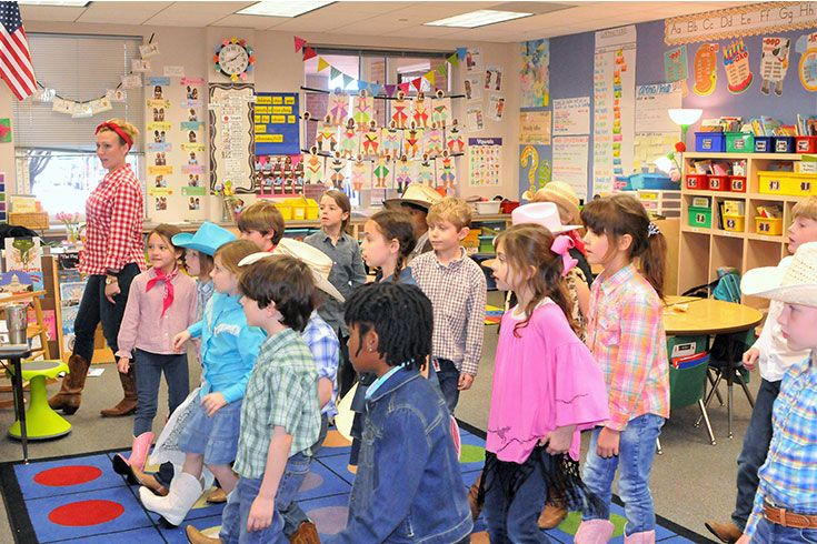 After studying symbols of Texas and America, students celebrate by learning a classic Texas line dance.