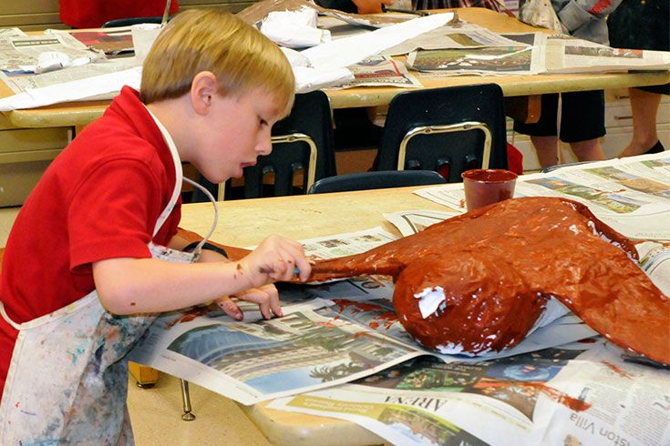 The bird unit extends beyond the traditional classroom to the art studio, computer class, and library. Life-sized paper mache bird sculptures soar overhead in the library, and bird calls provide a cheerful musical soundtrack. Kids even share their books with their Prekindergarten reading buddies.