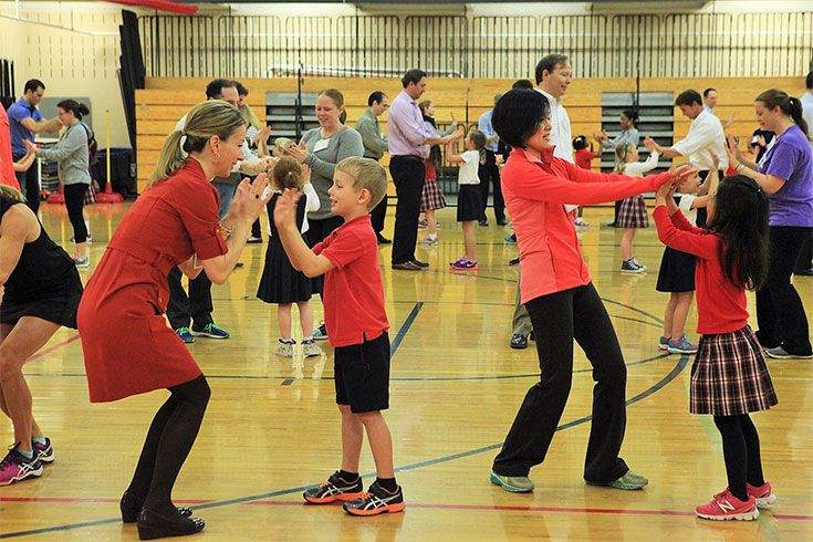 Parents get in the swing of P.E. at the annual Parent Child Dance.