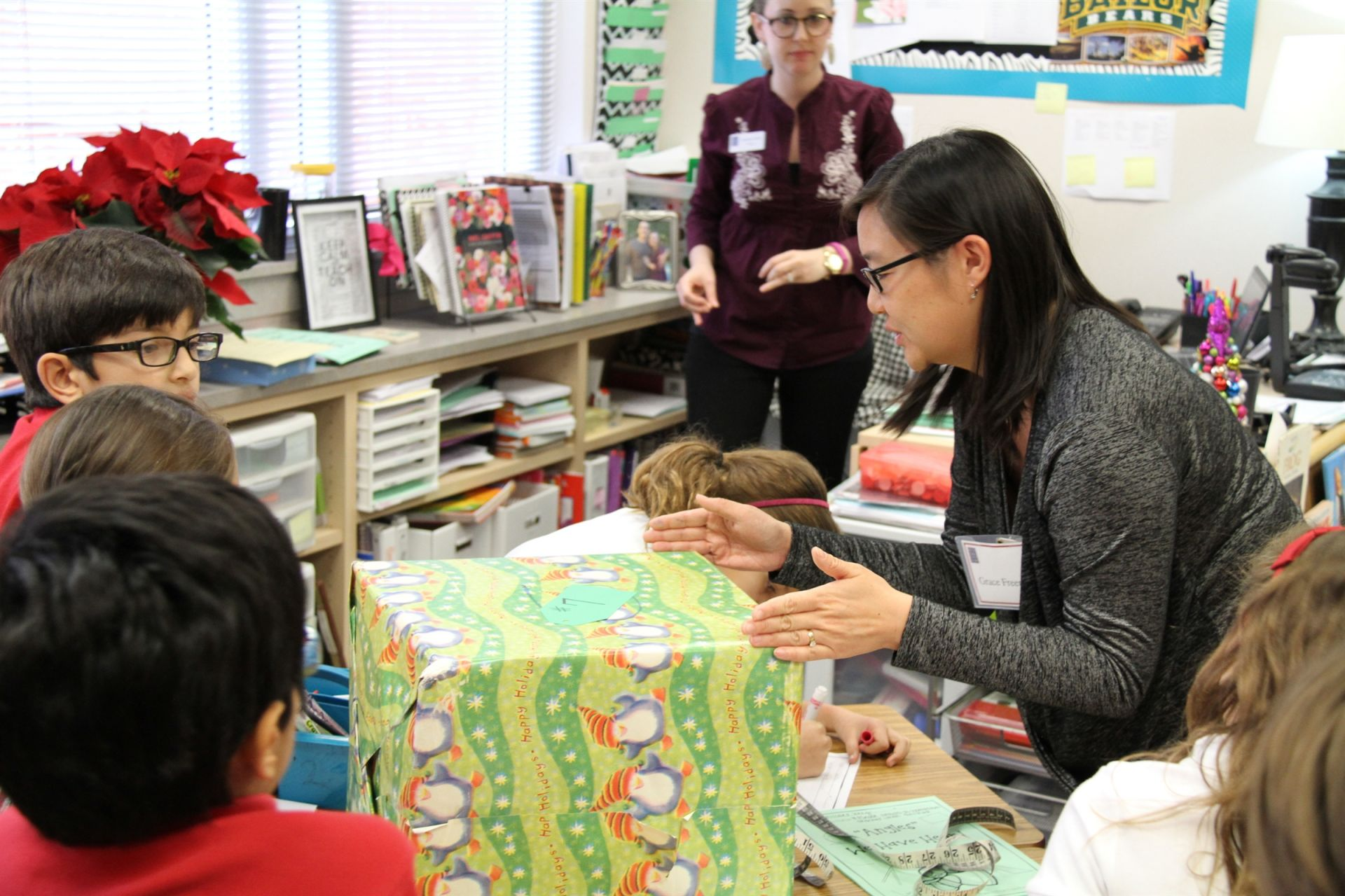 Students learn to apply math to real-world situations like wrapping Christmas presents.