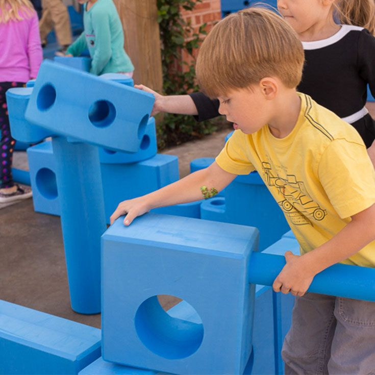 They look like giant foam tinker toys, but they are actually an amazing tool for learning. The oversized forms—rectangles and cylinders and chutes—inspire our littlest engineers to create their own playscapes. From castles to obstacle courses, there are endless possibilities to the playgrounds our students can create.