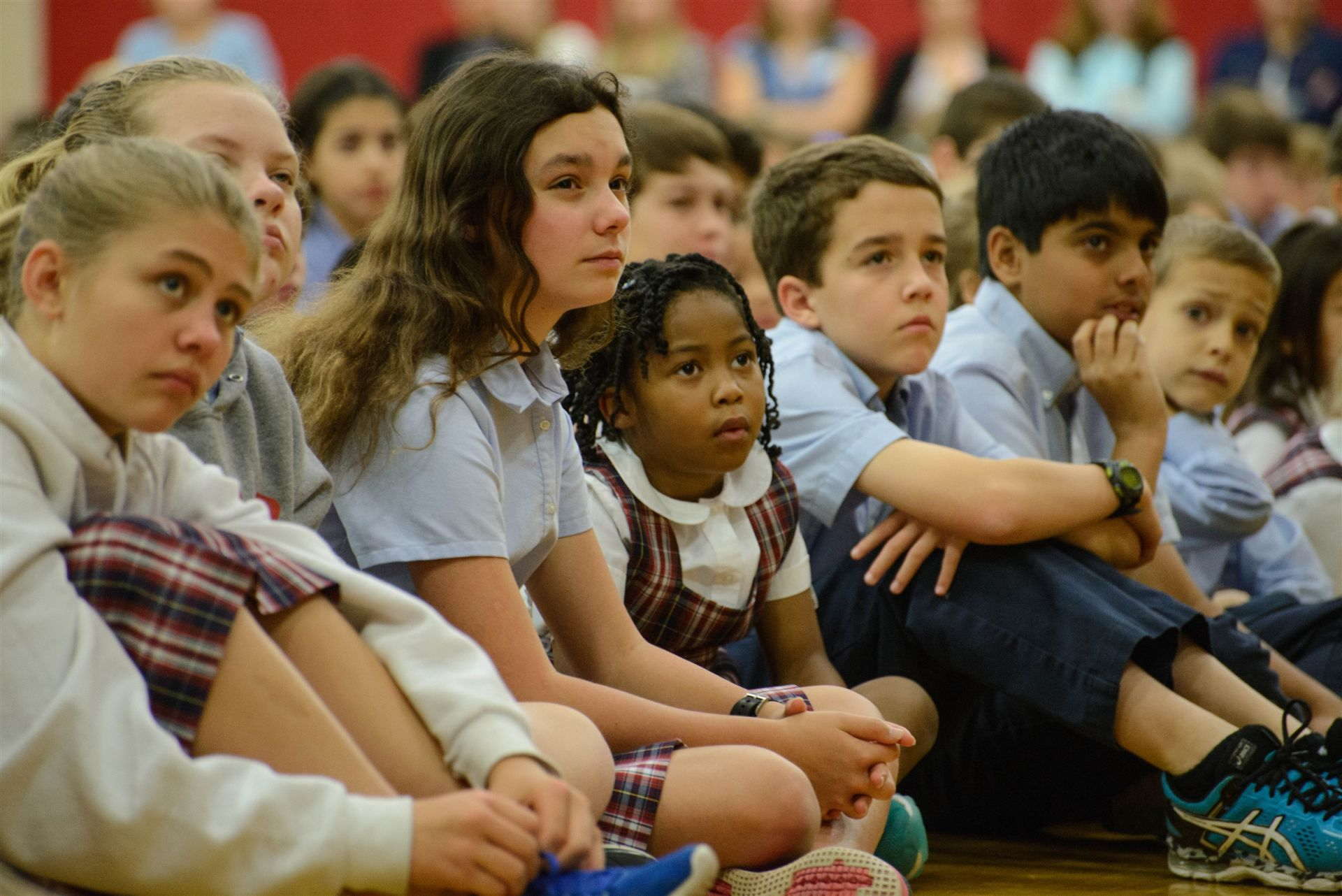 The buddy program reinforces every aspect of our curriculum--academics, character, and faith. Here friends of different ages worship together at a designated buddy chapel.