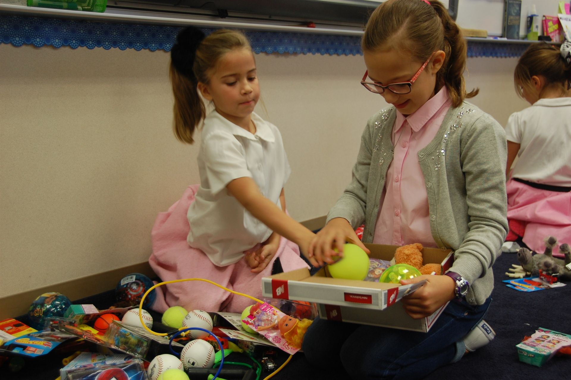 Buddies make Christmas gift boxes for children abroad.