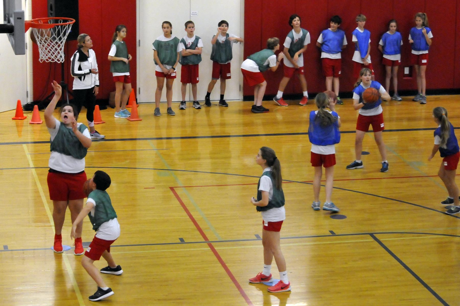 Sixth graders shoot hoops to earn money for overseas water wells.