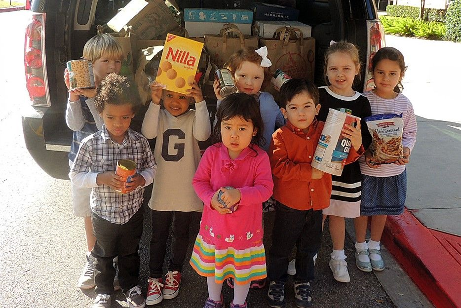 Preschool kids provide food to restock a local food pantry.