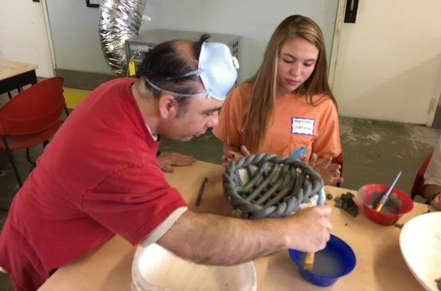 Seventh graders work alongside Brookwood citizens in the ceramics studio.