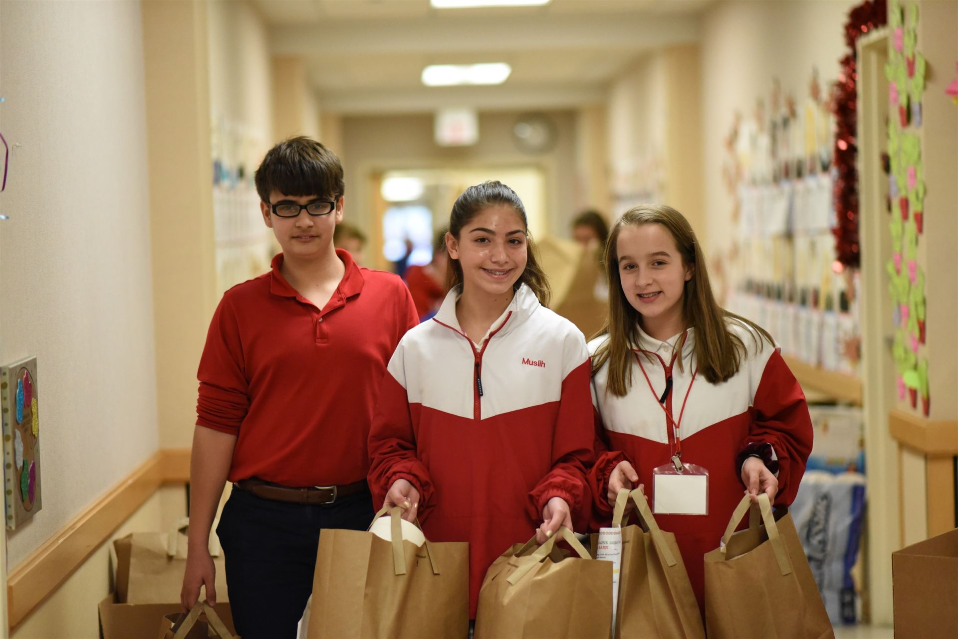 Students pack donations for GANO Mission Centers.