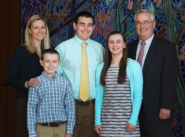 Portrait of Eagle Hill School Headmaster PJ McDonald and his family inside the Cultural Center.