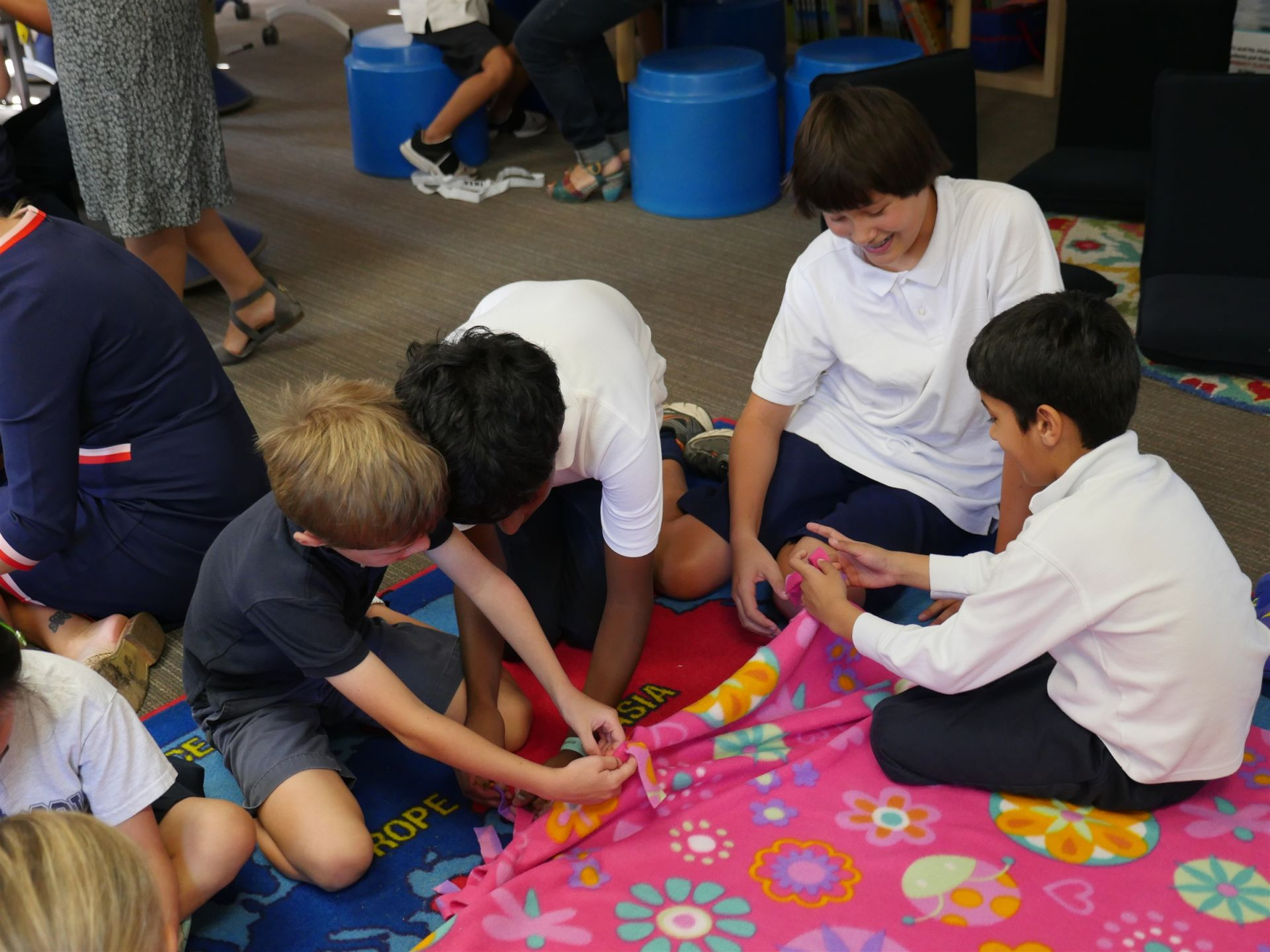 Middle School and Lower School buddies work together to make blankets for Project Linus during Hillbrook's Week Of Service.