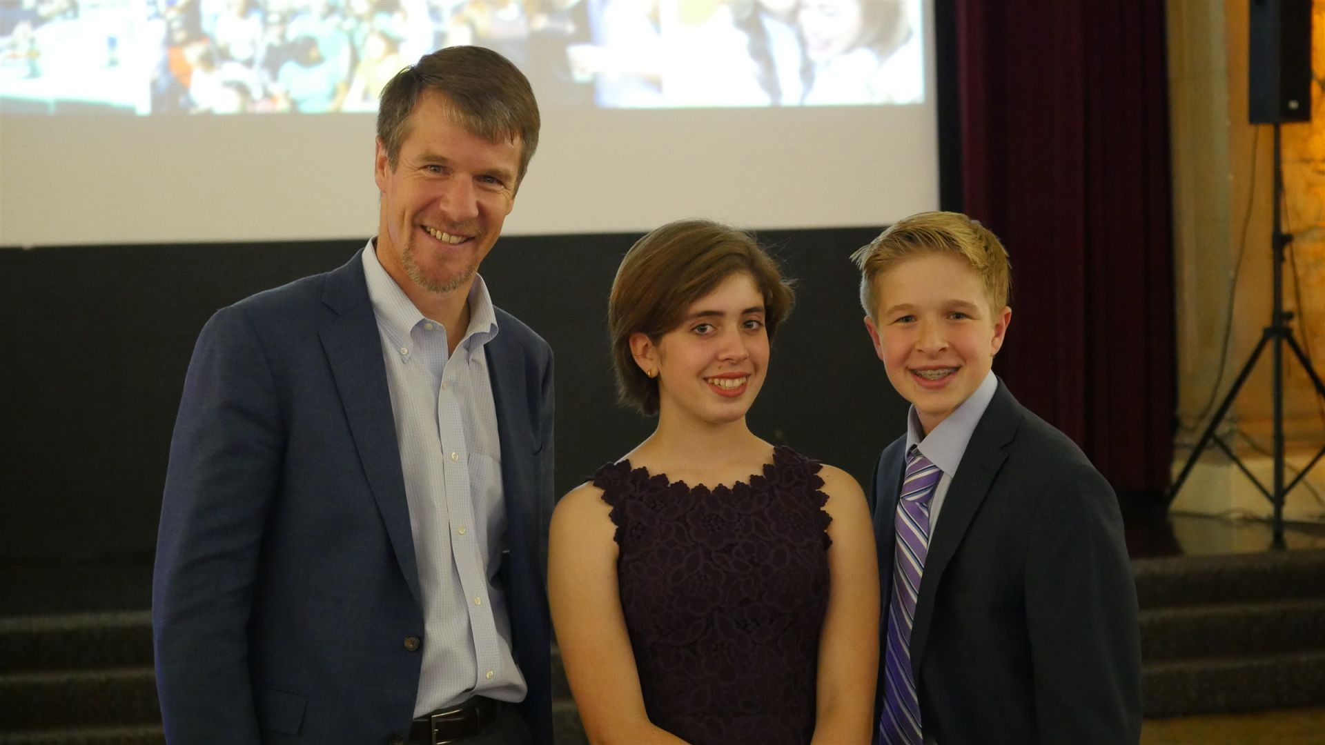Hillbrook students Joanna and Jackson with Head of School Mark Silver at the Kiva San Jose launch party on November 1, 2017.