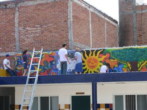 Lick students painted a giant mural at Casa Hogar.