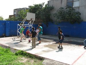 The Lick group organized basketball and soccer games -- note the dual purpose hoop and goal.