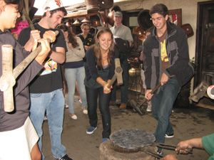 Students visited artisan workshops, including this forge at Sta. Clara del Cobre.