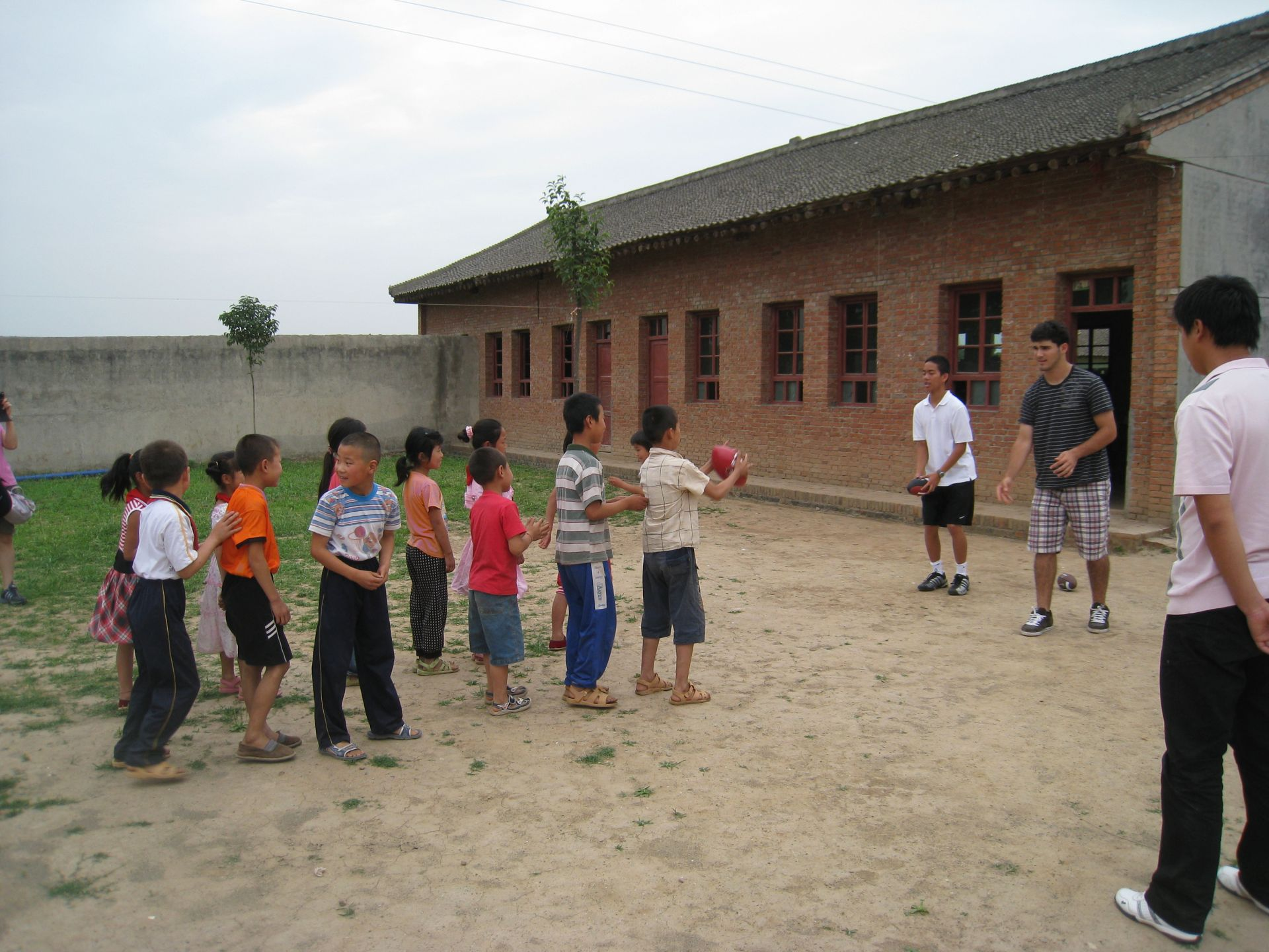 Service learning projects/community services included teaching English and sports to elementary school students in a rural village school; teaching English and interact with elementary to middle school students in a modern English school in Xian.