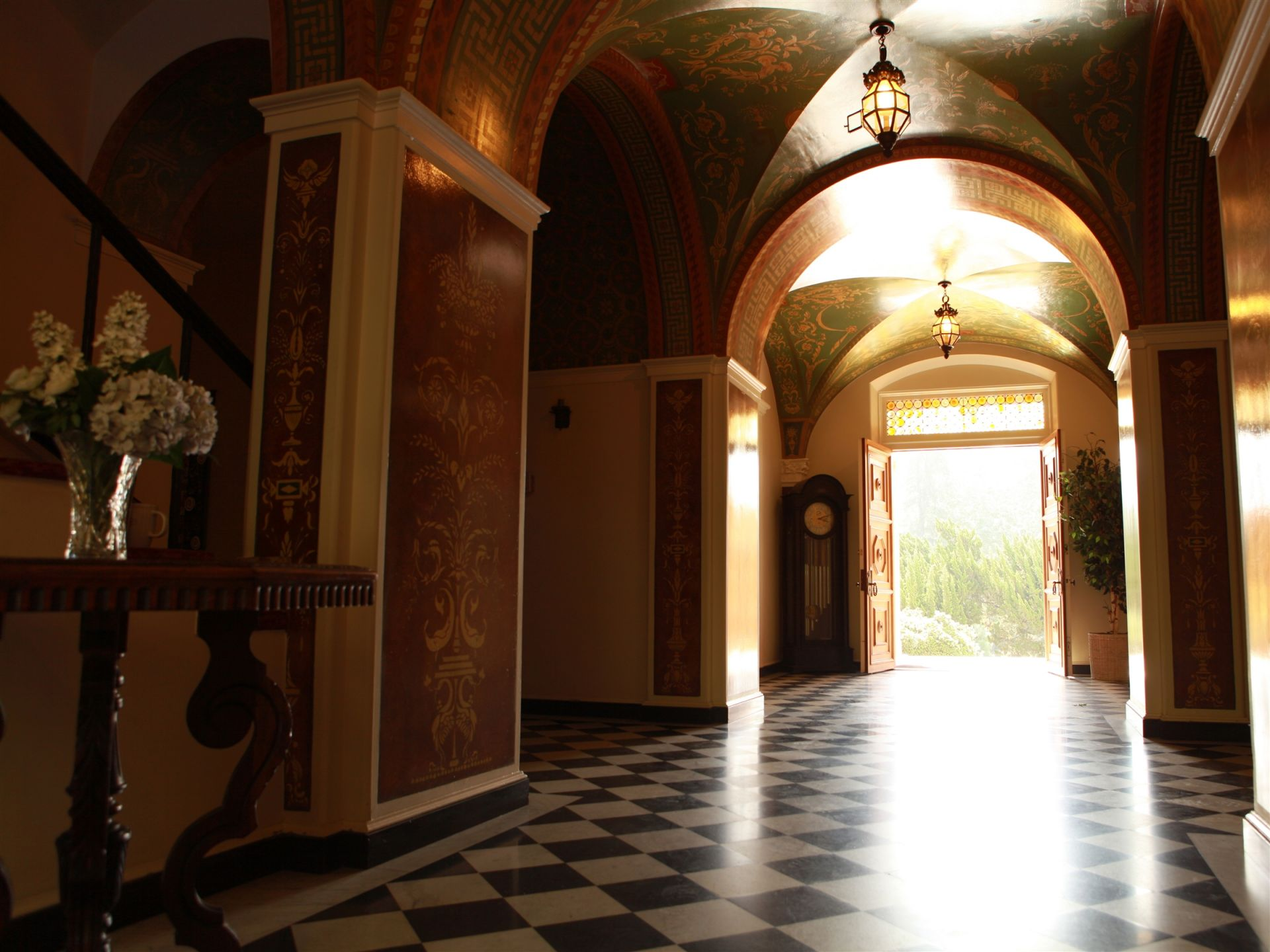 Inside the foyer, the architectural masterpiece is highlighted by beautiful hand-painted walls and ceilings.