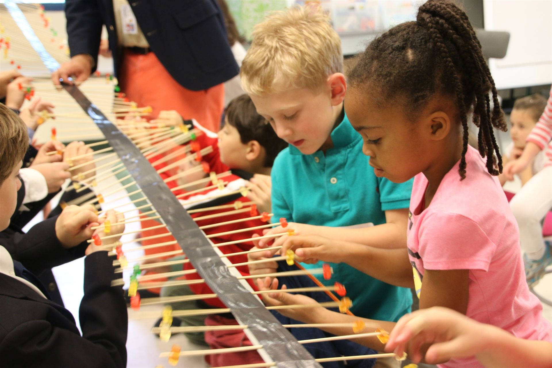 First Grade students created a Gummy Bear wave machine to demonstrate the way in which waves travel.