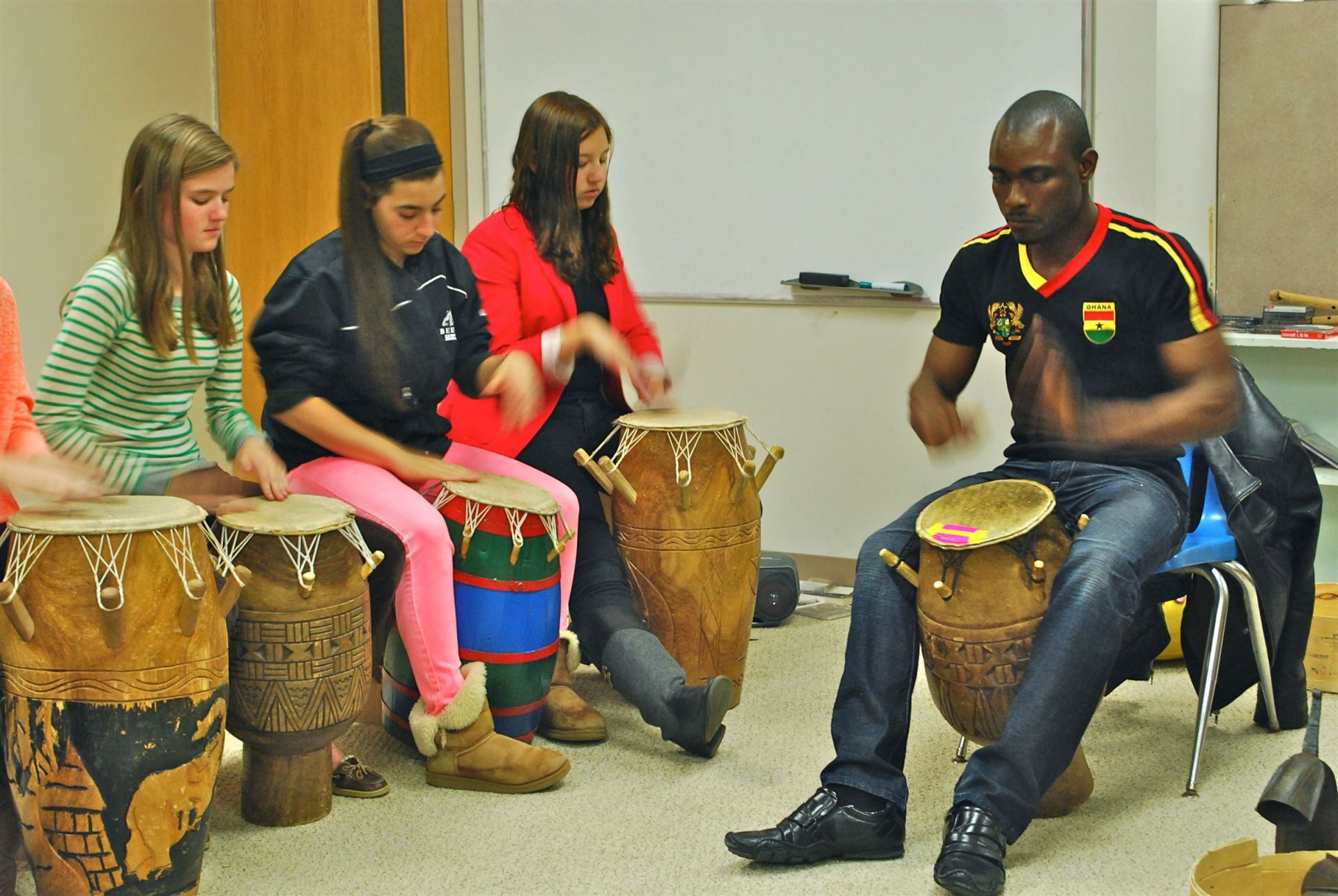 Our African Ensemble course focuses on the traditional music of the Ewe people of Ghana and the Shona of Zimbabwe. Students drum, sing and specialize on marimba or kalimbe. In recent years, we have welcomed Nani Agbeli, a visiting professor from Tufts University who shared his own cultural experience from Ghana, Africa while working with our students. It has become a school tradition for our African drumming students to open every All-School assembly as our students arrive.