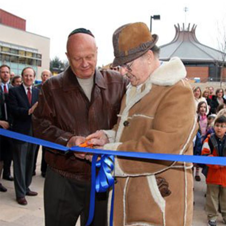 Marvin H. Weiner and Haron Dahan cut the ribbon to dedicate the new Lower School at Old Court on January 5, 2009.