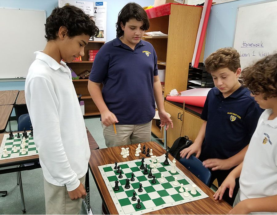 Falcon Summer Camp playing chess