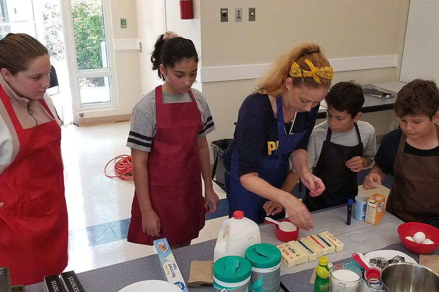 Falcon Summer Camp instructor teaching campers about baking