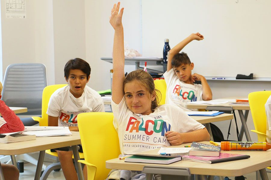 Falcon Summer Camp participants in a classroom doing school work