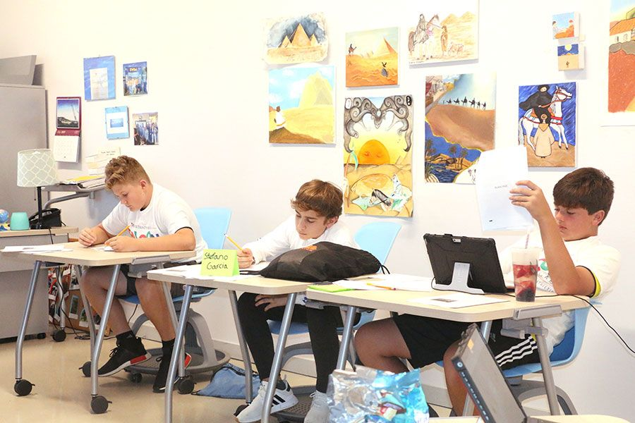 Falcon Summer Camp participants working at their desks