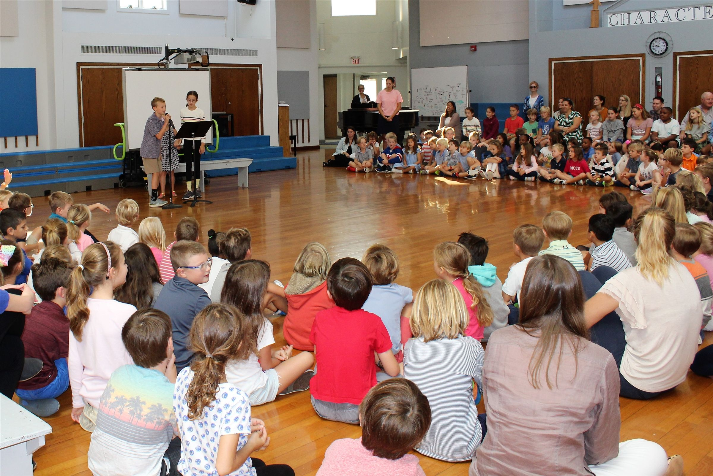 Each week, the Lower School community gathers to sing together, laugh together, and hear from each other during Assembly. This is our version of a family gathering around the dinner table; we give each other our full attention and share our stories. While Lower School Assembly is a joyful part of our week, is it also an invaluable public speaking experience to build competence and confidence.