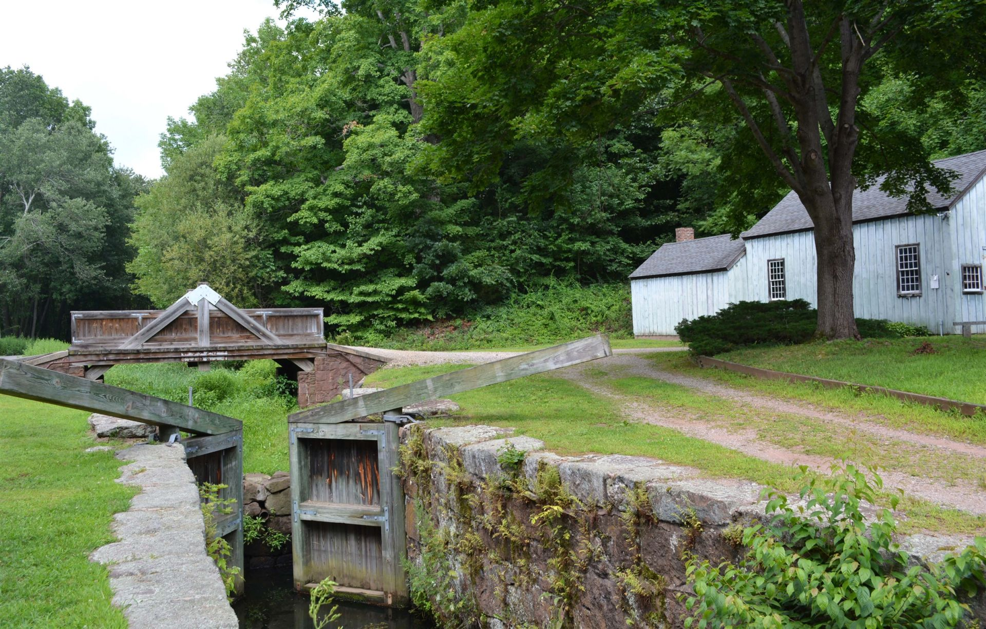Wooden gates, or locks, allowed barges to travel along the former Farmington Canal which passed through Cheshire. The popular Lock 12 Park is located off North Brooksvale Road.