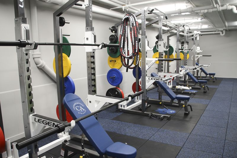 The Simosa Center is a place for the Academy's varsity student-athletes to work on strength and conditioning with their supervising coaches and the athletic training staff. Four custom power racks from Legend Fitness allow a number of groups to work simultaneously in the room, while a turf-covered area gives athletes room to warm-up, stretch, and conduct drills.