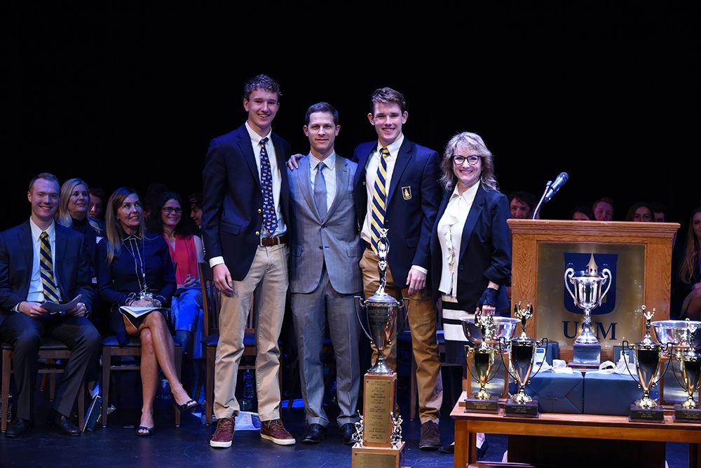 Libby MDS'55 and Jim MCDS'55 Wigdale. Accepted by their grandsons Ryan '19 and Michael '22 Kennedy