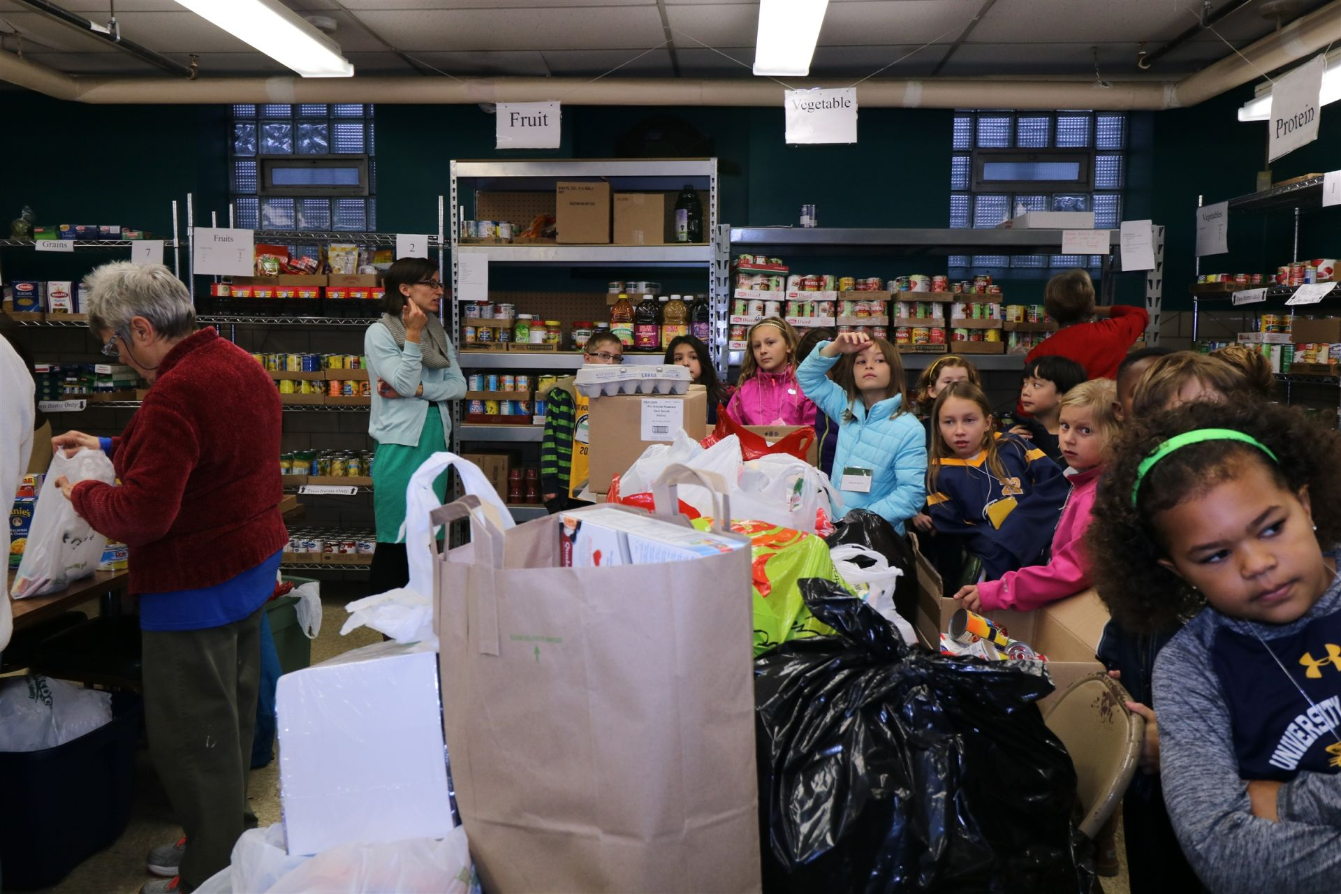 Students unpack bags of food at the Riverwest Food Pantry.